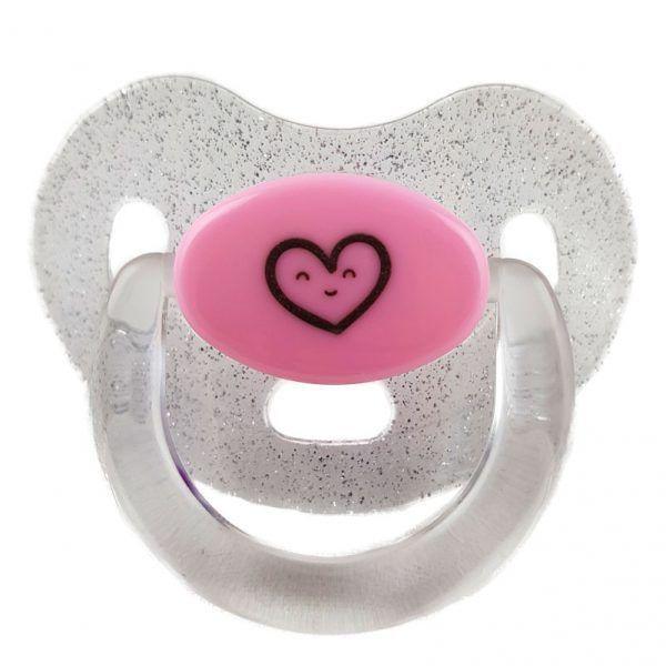 Chupete para bebés transparente de purpurina con el centro en color rosa y un corazón en negro