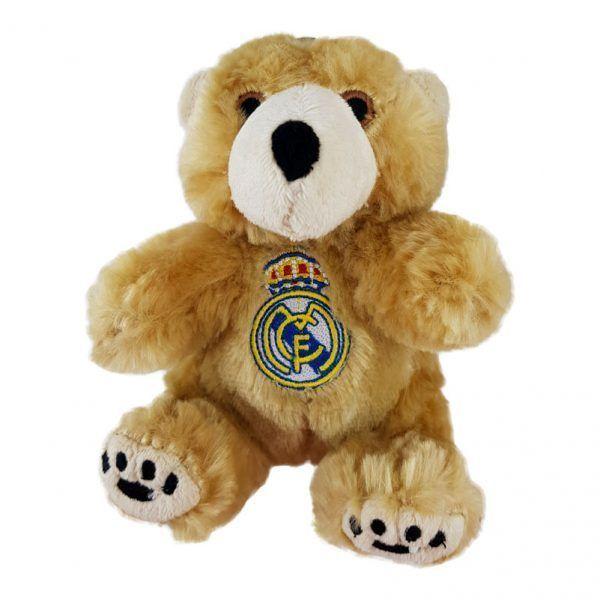 Oso de peluche de color beige claro con el escudo del Real Madrid grabado en el pecho.